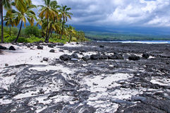 Storm clouds on a lava beach Royalty Free Stock Images