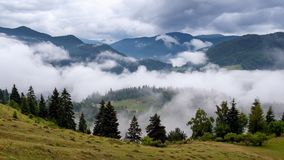 Storm clouds and mist in the Romanian Carpathian mountain during summer time Royalty Free Stock Images