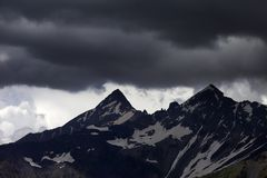 Storm clouds in mountains Stock Images