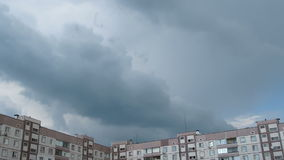 Storm Clouds Moving over the Multistorey Buildings Time Lapse. Clouds Moving over the Multistorey Buildings Time Lapse. Yard in the city with high-rise buildings stock video