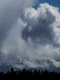 Storm clouds obscure mountain peaks Royalty Free Stock Photo