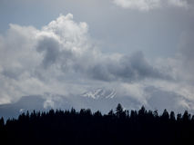 Storm clouds obscure mountain peaks Stock Photos