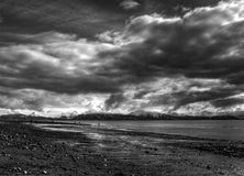Storm clouds over an Alaskan beach Royalty Free Stock Images