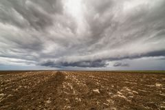 Storm clouds over arable land. Agricultural landscape Royalty Free Stock Photo