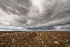 Storm clouds over arable land. Agricultural landscape Royalty Free Stock Photography