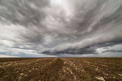 Storm clouds over arable land. Agricultural landscape Royalty Free Stock Photos