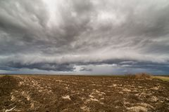 Storm clouds over arable land. Agricultural landscape Royalty Free Stock Image