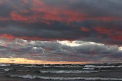 Storm Clouds Over a Beach at Sunset stock photos