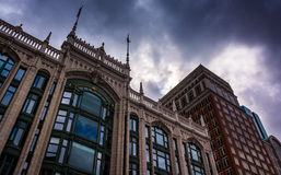 Storm clouds over buildings in Boston, Massachusetts. Stock Photos