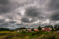 Storm clouds over buildings in an industrial park in York County Stock Photo