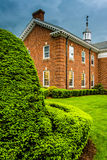 Storm clouds over bushes and a building at the Lutheran Seminary Stock Photos