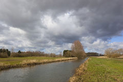 Storm clouds over canal Stock Image