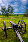 Storm clouds over a cannon in Gettysburg, Pennsylvania. Royalty Free Stock Photos