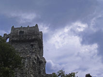 Storm Clouds Over Castle. Storm clouds pass by a nearby castle. It is a very Gothic and creepy scene Stock Images