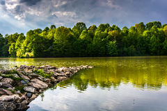 Storm clouds over Centennial Lake, at Centennial Park, in Columbia, Maryland. royalty free stock photo