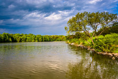 Storm clouds over Centennial Lake, at Centennial Park, in Columbia, Maryland. royalty free stock photography