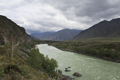 Storm clouds over Chuysky Trakt and river Katun Royalty Free Stock Image