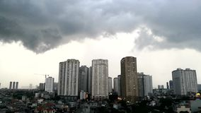 Storm clouds over city stock video footage