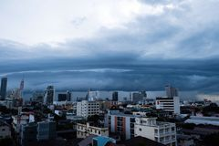 Storm clouds over the city, The sky is covered with black storm. Clouds stock images