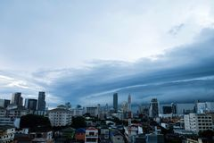 Storm clouds over the city, The sky is covered with black storm. Clouds royalty free stock image