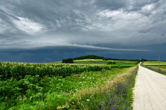 Storm Clouds Over a Country Road Stock Photography