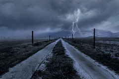 Horror Scene of a Stormy Clouds Over A Country Road Stock Image