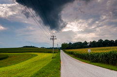 Storm clouds over a country road in York County, Pennsylvania. Royalty Free Stock Photo