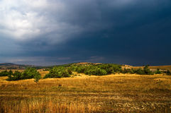Storm clouds over countryside. Scenic view of dark storm clouds over countryside Royalty Free Stock Image