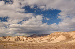 Storm clouds over death valley. Death valley as the sun sets in the west with storm clouds Royalty Free Stock Photo