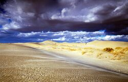 Storm clouds over desert landscape Royalty Free Stock Photos
