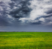 Storm clouds over field Royalty Free Stock Photography