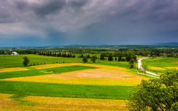 Storm clouds over fields and distant mountains seen from Longstr Royalty Free Stock Photo