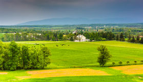 Storm clouds over fields and distant mountains seen from Longstr Royalty Free Stock Image