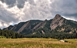 Storm clouds over the Flatiron mountains in Boulder, Colorado. Storm clouds hand over the Flatiron rock formations, part of the Rocky Mountain foothills just Royalty Free Stock Photography
