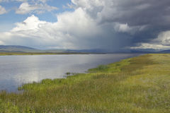 Storm clouds over grasslands and mountains at Red Rock Lake in Centennial Valley, near Lakeview, MT Royalty Free Stock Image