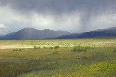 Storm clouds over grasslands and mountains at Red Rock Lake in Centennial Valley, near Lakeview, MT Stock Photography