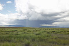 Storm clouds over grasslands and mountains at Red Rock Lake in Centennial Valley, near Lakeview, MT Royalty Free Stock Images