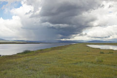 Storm clouds over grasslands and mountains at Red Rock Lake in Centennial Valley, near Lakeview, MT Stock Photo