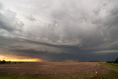 Storm clouds over Kansas plains. Threatening, dark skies from a thunderstorm with rain and lightning over the Kansas crop plains Royalty Free Stock Photos