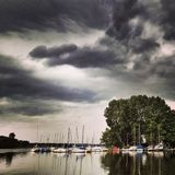 Storm clouds over lake Royalty Free Stock Photo