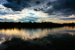Storm clouds over lake shore Royalty Free Stock Photography