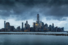 Storm Clouds over Lower Manhattan skyscrapers. New York City Stock Photos
