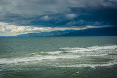 Storm clouds over Malibu and the Pacific Ocean, seen from Venice. Beach, Los Angeles, California Stock Photography