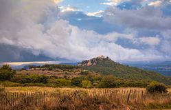 Storm clouds over medieval mountain castle stock photo
