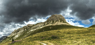 Storm clouds over the Mount Castellazzo Stock Image