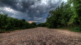Storm Clouds Over A Mountain Road.  HDR Time Lapse Shot Motorized Slider Stock Photography