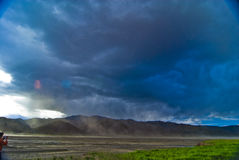 Storm clouds over mountains. Scenic view of storm clouds over mountains in Tibetan landscape Stock Photography