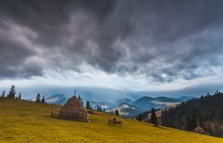 Storm clouds over the mountains Stock Images