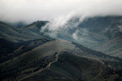 Storm Clouds Over Mountains with Roads Royalty Free Stock Images