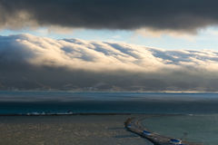 Storm clouds. Over the mountans before the sea storm Stock Photography